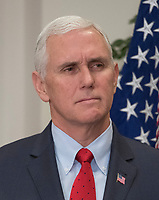 United States Vice President Mike Pence looks on prior to US President Donald J. Trump signing a proclamation to honor Dr. Martin Luther King, Jr. Day in the Roosevelt Room of the White House in Washington, DC on Friday, January 12, 2018.<br /> CAP/MPI/RS<br /> &copy;RS/MPI/Capital Pictures