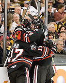 Huskies celebrate. - The Boston College Eagles defeated the Northeastern University Huskies 5-4 in their Hockey East Semi-Final on Friday, March 18, 2011, at TD Garden in Boston, Massachusetts.