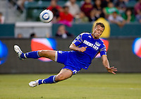 Kansas City Wizards midfielder Jack Jewsbury flying through the air getting after a loose ball. The Kansas City Wizards defeated CD Chivas USA 2-0 at Home Depot Center stadium in Carson, California on Sunday September 19, 2010.