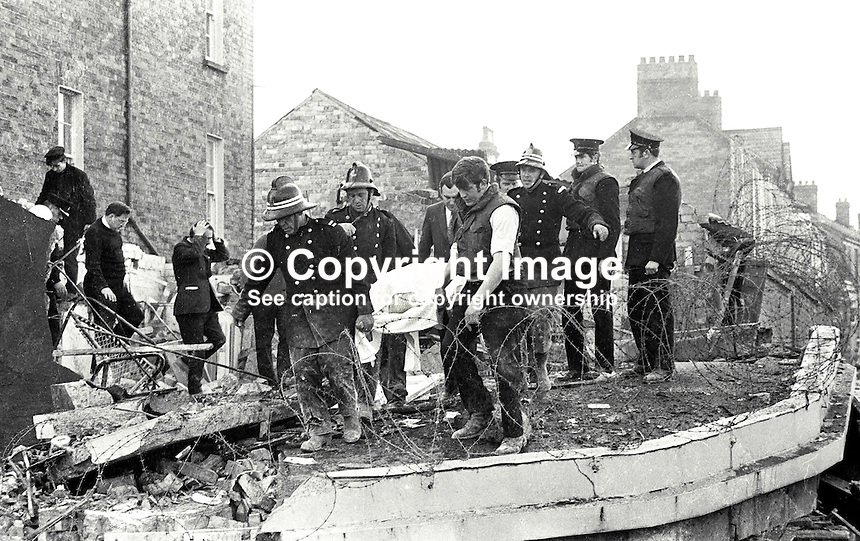 Rescuers among the debris following a Provisional IRA explosion at Chichester Road RUC Station, Belfast, N Ireland, UK, on 29 October 1971, in which the body of a victim is stretchered away. 428/71, 197110290428b.<br />