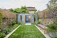 The aluminium clad studio in the garden was custom-built by London Garden Studios and is stylishly functional.