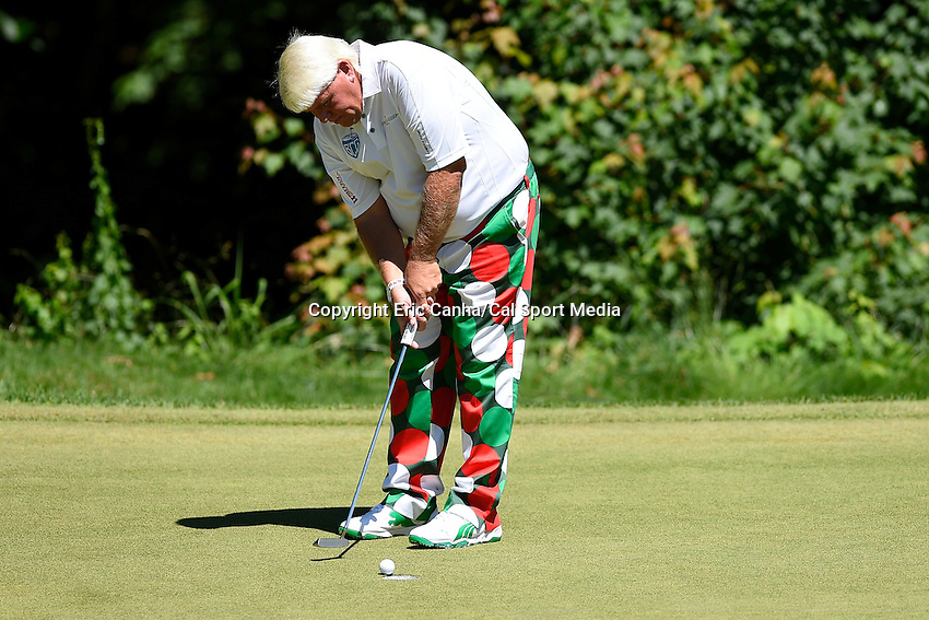 June 22, 2014 - Cromwell, Connecticut - John Daly makes a putt on the 10th green during the final round of the PGA Travelers Championship tournament held at TPC River Highlands in Cromwell, Connecticut.  Eric Canha/CSM