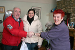 Barbara Tiernan and Michael Clarke from Drogheda Senior Citizens delivering groceries to Norma Thompson who has been unable to leave her house due to the bad weather...Photo NEWSFILE/Jenny Matthews.(Photo credit should read Jenny Matthews/NEWSFILE)....This Picture has been sent you under the condtions enclosed by:.Newsfile Ltd..The Studio,.Millmount Abbey,.Drogheda,.Co Meath..Ireland..Tel: +353(0)41-9871240.Fax: +353(0)41-9871260.GSM: +353(0)86-2500958.email: pictures@newsfile.ie.www.newsfile.ie.FTP: 193.120.102.198.