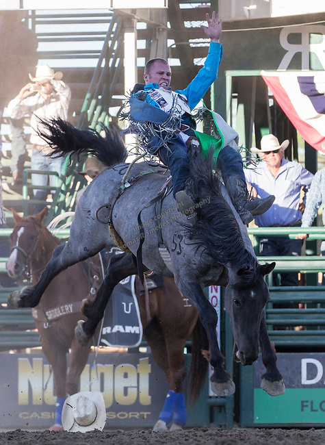 Pascal Isabelle rides in the Bareback Bronc Riding event during the Reno Rodeo on Sunday, June 23, 2019.