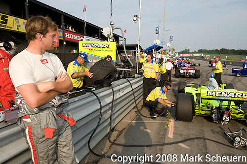 20 July 2008: AJ Foyt IV (USA) looks at teammate Ed Carpenter's car at the Honda Indy 200 IndyCar race at the Mid-Ohio Sports Car Course, Lexington, Ohio, USA.