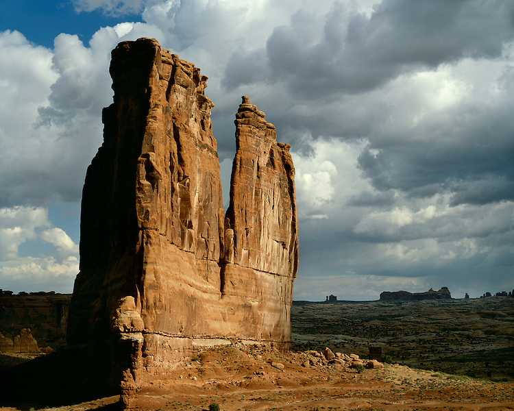 Light breaking through storm clouds above Courthouse Towers; Arches National Park, UT