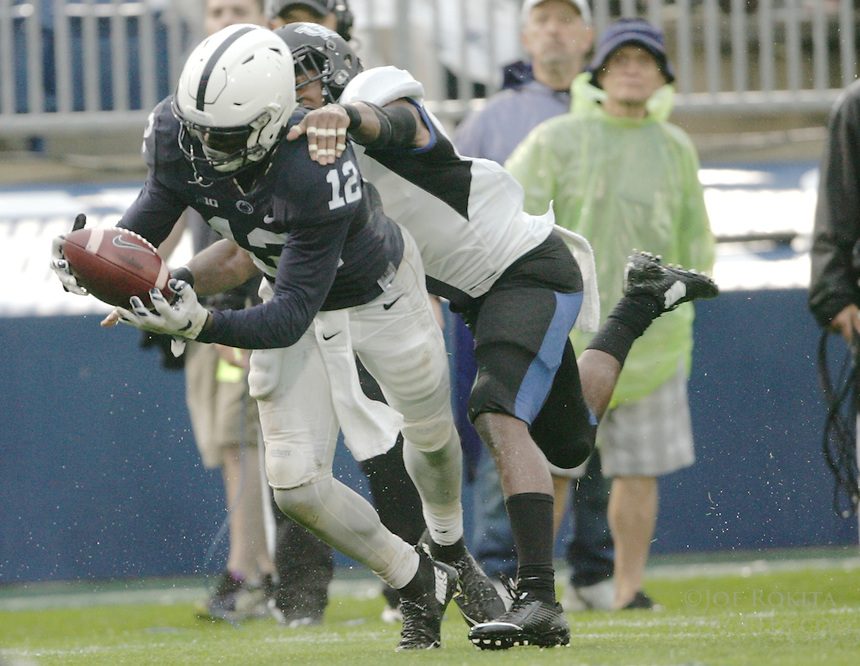 State College, PA - 09/12/2015:  Penn State WR Chris Godwin (12) catches a long pass amidst coverage by Buffalo CB Marqus Baker. Godwin led the Nittany Lion receivers with 5 catches for 75 yards. Penn State defeated Buffalo by a score of 27-14 at rainy Beaver Stadium in University Park, PA.<br /> <br /> Photos by Joe Rokita / JoeRokita.com