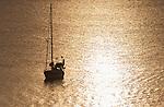 Sun setting over yacht in Niue