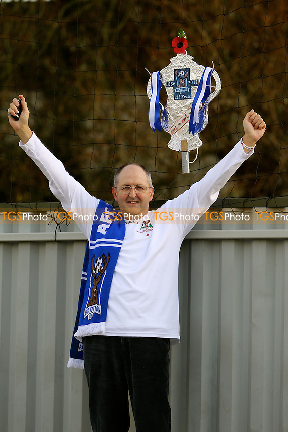 An AFC Totton fan gets in the party mood - AFC Totton vs Bradford Park Avenue - FA Challenge Cup 1st Round Football at the Testwood Stadium - 12/11/11 - MANDATORY CREDIT: Andy Nunn/TGSPHOTO - Self billing applies where appropriate - 0845 094 6026 - contact@tgsphoto.co.uk - NO UNPAID USE.