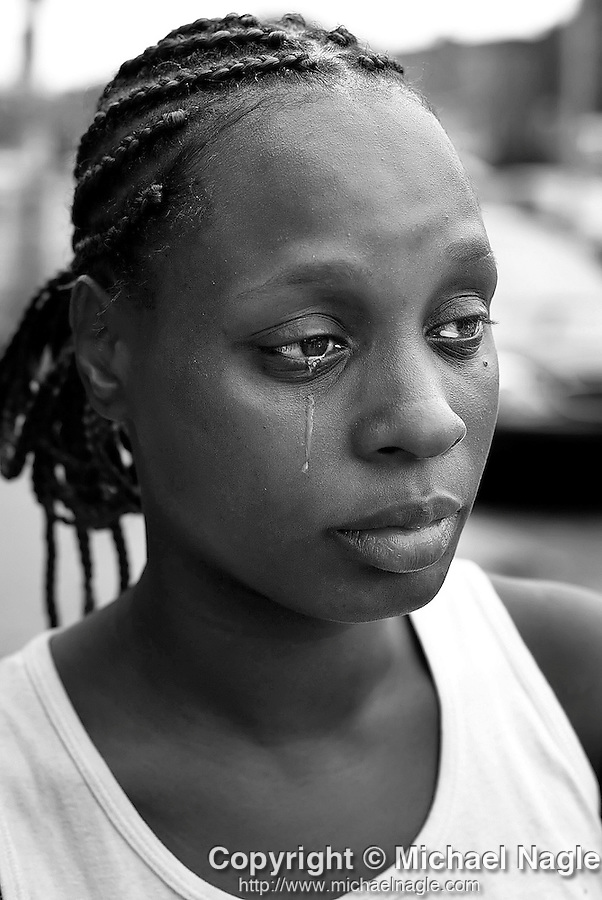 BROOKLYN - AUGUST 7, 2005:  Wakeema Golden cries in front of Brookdale Hostpital, where her 11 year-old daughter Brenda Fields was taken after she was shot in the face by a 10 year-old boy while playing a game of hide and seek, on August 7, 2005 in Brooklyn.  The gun belonged to the boy's 16 year-old older brother.  (PHOTOGRAPH BY MICHAEL NAGLE)