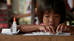 A girl works on as assignment in a preschool sponsored by the Kapatiran-Kaunlaran Foundation (KKFI) in Pulilan, a village in Bulacan, Philippines.<br /> <br /> KKFI is supported by United Methodist Women.