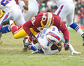 Buffalo Bills quarterback Tyrod Taylor (5) is sacked in the fourth quarter by Washington Redskins linebacker Preston Smith (94) at FedEx Field in Landover, Maryland on Sunday, December 20, 2015.  The Redskins won the game 35-25.<br /> Credit: Ron Sachs / CNP