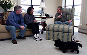 """United States President George W Bush, right, works with Chief of Staff Andrew Card, left, and National Security Advisor Dr. Condoleezza Rice along with the President's dog """"Barney"""" at the President's new home on his Crawford, Texas ranch on February 17, 2001. It was the President's fist visit back home to Texas after moving to the White House. <br /> Mandatory Credit: Paul Morse / White House via CNP"""