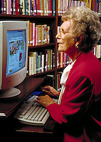 Senior woman using the internet.
