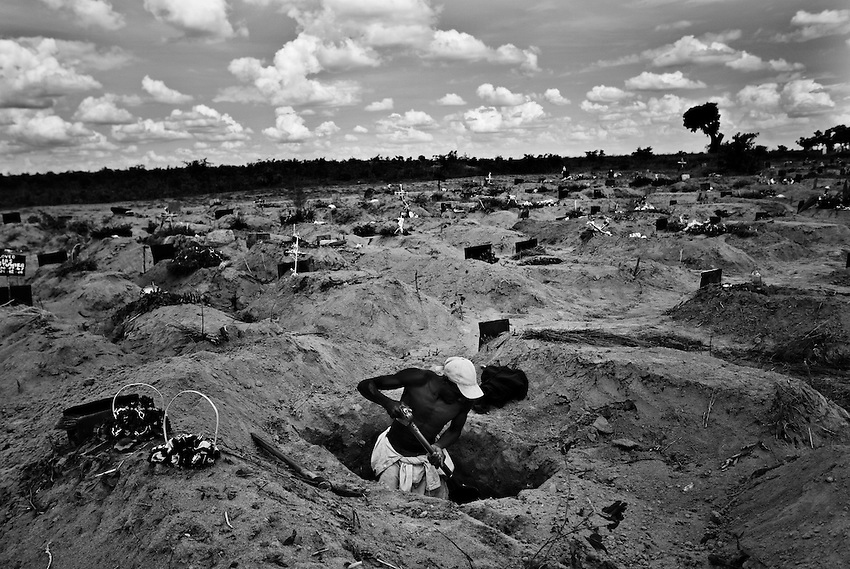 A cemetary worker digs a grave for a 7-year-old child that died of cholera in the B Wing of the Granaville Cemetary, designated for cholera victims, near Budiriro, Zimbabwe, Sunday, December 14, 2008.