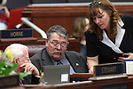 Assembly members, from left,  Lynn Stewart, R-Henderson, Pete Goicoechea, R-Eureka, and Marilyn Kirkpatrick, D-North Las Vegas, talk on the Assembly floor on April 18, 2011, at the Legislature in Carson City, Nev. .Photo by Cathleen Allison