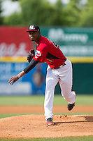 Hickory Crawdads starting pitcher Yohander Mendez (21) follows through on his delivery against the Savannah Sand Gnats at L.P. Frans Stadium on June 14, 2015 in Hickory, North Carolina.  The Crawdads defeated the Sand Gnats 8-1.  (Brian Westerholt/Four Seam Images)
