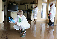 NWA Democrat-Gazette/DAVID GOTTSCHALK Pat Faubus photographs Tuesday, June 4, 2019, the water level on the walls of her home on Riverview Drive in Fort Smith. Faubus was joined by her husband Don and daughters as they entered their home for the first time following flooding by the Arkansas River.