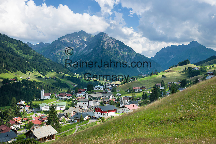 Austria, Vorarlberg, Kleinwalsertal, Hirschegg: village centre with catholic church Saint Anne, evangelic Cross Church and Allgaeu Alps with summit Widderstein | Oesterreich, Vorarlberg, Kleinwalsertal, Hirschegg: Ortszentrum mit katholischer St. Anna Kirche und der evangelischen Kreuzkirche vor den Allgaeuer Alpen mit Widderstein