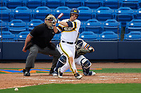 Michigan Wolverines third baseman Jake Bivens (18) at bat in front of catcher Nick Capitano and umpire Robert Lothian during the first game of a doubleheader against the Canisius College Golden Griffins on June 20, 2016 at Tradition Field in St. Lucie, Florida.  Michigan defeated Canisius 6-2.  (Mike Janes/Four Seam Images)