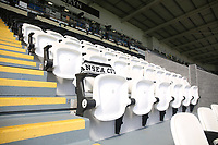 A lone seat in the directors area is marked with a scarf in memory of Gwilym Joseph MBE, Swansea City's honorary president, who passed away earlier this week prior to kick off of the Premier League match between Swansea City and Manchester United at The Liberty Stadium, Swansea, Wales, UK. Saturday 18 August 2017