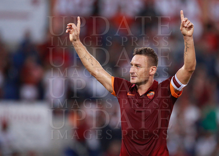 Calcio, Serie A: Roma vs ChievoVerona. Roma, stadio Olimpico, 18 ottobre 2014.<br /> Roma's Francesco Totti celebrates after scoring on a penalty kick during the Italian Serie A football match between Roma and ChievoVerona at Rome's Olympic stadium, 18 October 2014.<br /> UPDATE IMAGES PRESS/Isabella Bonotto