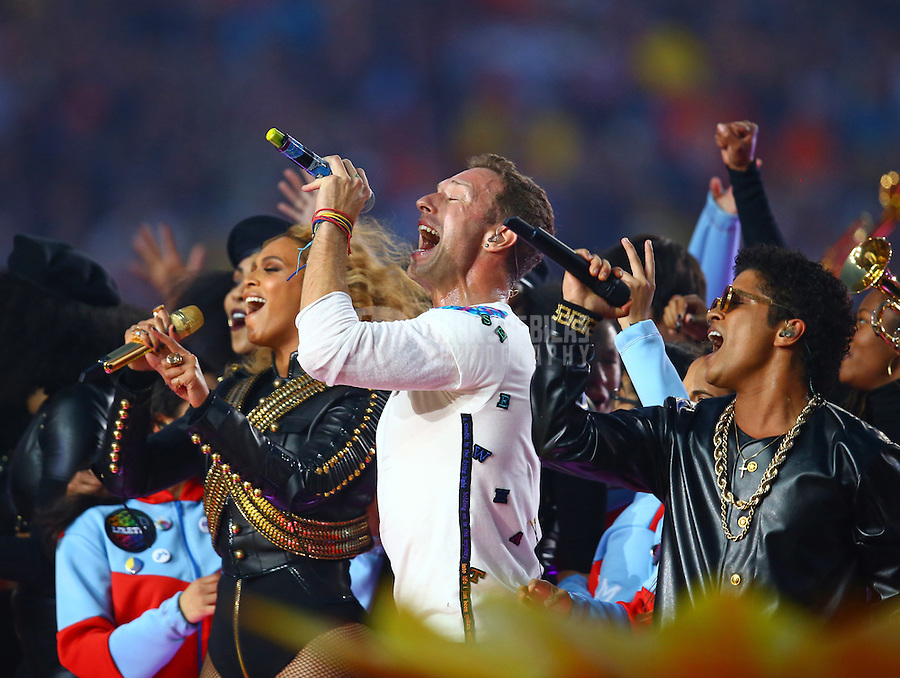 Feb 7, 2016; Santa Clara, CA, USA; Recording artists from left Beyonce , Chris Martin of Coldplay and Bruno Mars perform at halftime in Super Bowl 50 between the Carolina Panthers and the Denver Broncos at Levi's Stadium. Mandatory Credit: Mark J. Rebilas-USA TODAY Sports