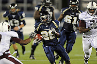 6 November 2010:  FIU running back Darrian Mallary (26) carries the ball in the third quarter as the FIU Golden Panthers defeated the University of Louisiana-Monroe Warhawks, 42-35 in double overtime, at FIU Stadium in Miami, Florida.
