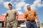 Pete Lanteri and Larry Fortney watch a suspicious plane fly over Camp Swift military base in Bastrop, Texas.