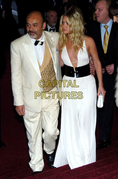"""CHRISTIAN LOUBOUTIN & ASHLEY OLSEN .2007 Metropolitan Museum of Art Costume Institute Gala celebrating """"Poiret: King of Fashion"""" exibition at the Metropolitan Museum of Art, New York City, New York, USA..May 7th, 2007.full length white pleated plunging neckline dress cleavage clutch purse black wide belt cream beige suit waiscoat gold.CAP/ADM/BL.©Bill Lyons/AdMedia/Capital Pictures *** Local Caption ***"""