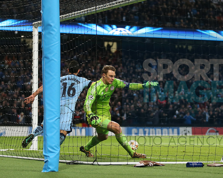 Manuel Neuer of Bayern Munich tries stop \mc16 getting the ball back after scoring the equalising goal  - UEFA Champions League group E - Manchester City vs Bayern Munich - Etihad Stadium - Manchester - England - 25rd November 2014  - Picture Simon Bellis/Sportimage