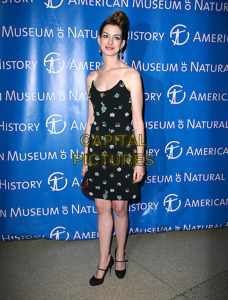 ANNE HATHAWAY.The American Museum of Natural History's 2010 Museum Gala at the American Museum of Natural History, New York City, NY, USA..November 18th, 2010.full length dress beads beaded black strapless hair up coif purple clutch bag mary janes shoes .CAP/ADM/PZ.©Paul Zimmerman/AdMedia/Capital Pictures.
