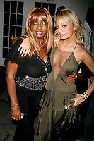 JANICE COMBS AND NICOLE RICHIE<br /> OLYMPUS FASHION WEEK: <br /> ZAC POSEN SPRING 2005-CELEBS.<br /> BRYANT PARK,NEW YORK CITY 9/10/2004<br /> Photo By John Barrett/PHOTOlink