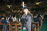 Heidi Hess celebrates at graduate commencement ceremonies. Photo by Ben Siegel