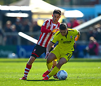 Lincoln City's Tom Pett vies for possession with Cheltenham Town's Billy Waters<br /> <br /> Photographer Andrew Vaughan/CameraSport<br /> <br /> The EFL Sky Bet League Two - Lincoln City v Cheltenham Town - Saturday 13th April 2019 - Sincil Bank - Lincoln<br /> <br /> World Copyright © 2019 CameraSport. All rights reserved. 43 Linden Ave. Countesthorpe. Leicester. England. LE8 5PG - Tel: +44 (0) 116 277 4147 - admin@camerasport.com - www.camerasport.com