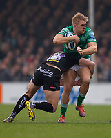 Newcastle Falcons' Chris Harris is tackled by Exeter Chiefs' Ollie Devoto<br /> <br /> <br /> Photographer Bob Bradford/CameraSport<br /> <br /> Gallagher Premiership - Exeter Chiefs v Newcastle Falcons - Saturday 23rd February 2019 - Sandy Park - Exeter<br /> <br /> World Copyright © 2019 CameraSport. All rights reserved. 43 Linden Ave. Countesthorpe. Leicester. England. LE8 5PG - Tel: +44 (0) 116 277 4147 - admin@camerasport.com - www.camerasport.com