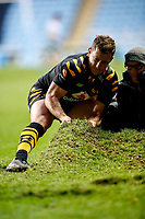 5th January 2020; Ricoh Arena, Coventry, West Midlands, England; English Premiership Rugby, Wasps versus Northampton Saints; Jimmy Gopperth of Wasps helps with repairing the lifted turf during the game - Editorial Use