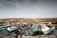Lampedusa, Giugno 2008. Il cimitero delle barche utilizzate dagli immigrati per raggiungere l'isola di Lampedusa ammassate in un deposito nel centro dell'isola.