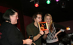 GH - Bradford Anderson & Julie Berman with fan who gave Bradford a photos of himself & Steve Burtonbat the Brokerage Comedy Club on February 21, 2009 in Bellmore, New York to see their fans as they sign and pose for photos, do a show for the fans and Bradford plays Simon Says with his fans. ALSO Bradford sang for all and he was great. (Photo by Sue Coflin/Max Photos)
