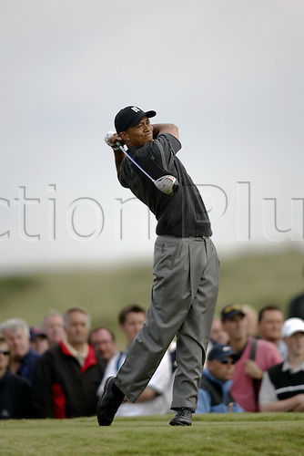 15 July 2004: American golfer TIGER WOODS (USA) looks into the distance after playing his tee shot at the 15th on his way to a first round of 70 at The Open Championship, Royal Troon, Scotland. Photo: Glyn Kirk/Action Plus...golf golfer golfers 040715 full-length british