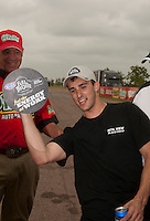 May 1, 2011; Baytown, TX, USA: NHRA pro stock driver Vincent Nobile celebrates after winning the Spring Nationals at Royal Purple Raceway. Mandatory Credit: Mark J. Rebilas-