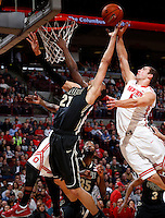 Ohio State Buckeyes guard Aaron Craft (4) leaps for a layup during the first half of the NCAA men's basketball game between the Ohio State Buckeyes and the Purdue Boilermakers at Value City Arena in Columbus, Ohio, on Saturday, Feb. 8, 2014. At the half, the Buckeyes led 29-22.  (Columbus Dispatch/Sam Greene)