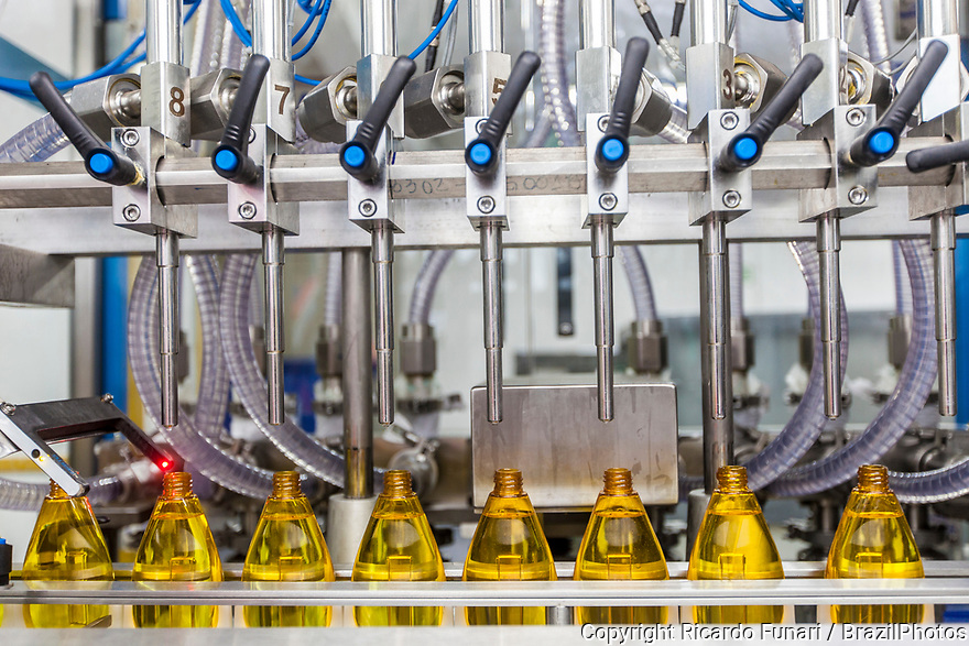 Multinational cosmetics company headquartered in France L`Oreal plant in Rio de Janeiro, Brazil - Production line - automation - machine fills up empty bottles with comestic.