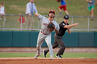 Chattanooga Lookouts third baseman Jonathan India (16) throws to first base as umpire Sam Burch signals fair ball during a Southern League game against the Birmingham Barons on July 24, 2019 at Regions Field in Birmingham, Alabama.  Chattanooga defeated Birmingham 9-1.  (Mike Janes/Four Seam Images)