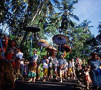 Religious procession through the countryside of Bali, Indonesia.