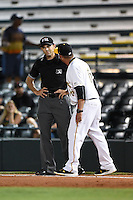 Bradenton Marauders manager Michael Ryan (16) argues a call with field umpire Alex Mackay during a game against the St. Lucie Mets on April 11, 2015 at McKechnie Field in Bradenton, Florida.  St. Lucie defeated Bradenton 3-2.  (Mike Janes/Four Seam Images)