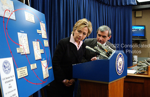 Washington, DC - December 1, 2003 -- United States Senators Hillary Rodham Clinton (Democrat of New York) and Jack Reed (Democrat of Rhode Island) look at a chart they brought to help them brief reporters on their recent trip to Afghanistan and Iraq in the United States Capitol in Washington, DC on December 1, 2003..Credit: Ron Sachs / CNP
