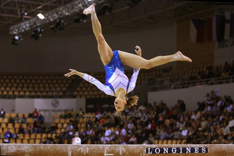 Oct 16, 2006; Aarhus, Denmark;  Sandra Izbasa of Romania performs on balance beam during women's gymnastics team competition at 2006 World Championships Artistic Gymnastics. Photo by Tom Theobald