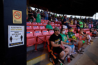 Signs in the grandstand to remind fans to social distance during a Collegiate Summer League game between the Macon Bacon and Savannah Bananas on July 15, 2020 at Grayson Stadium in Savannah, Georgia.  (Mike Janes/Four Seam Images)