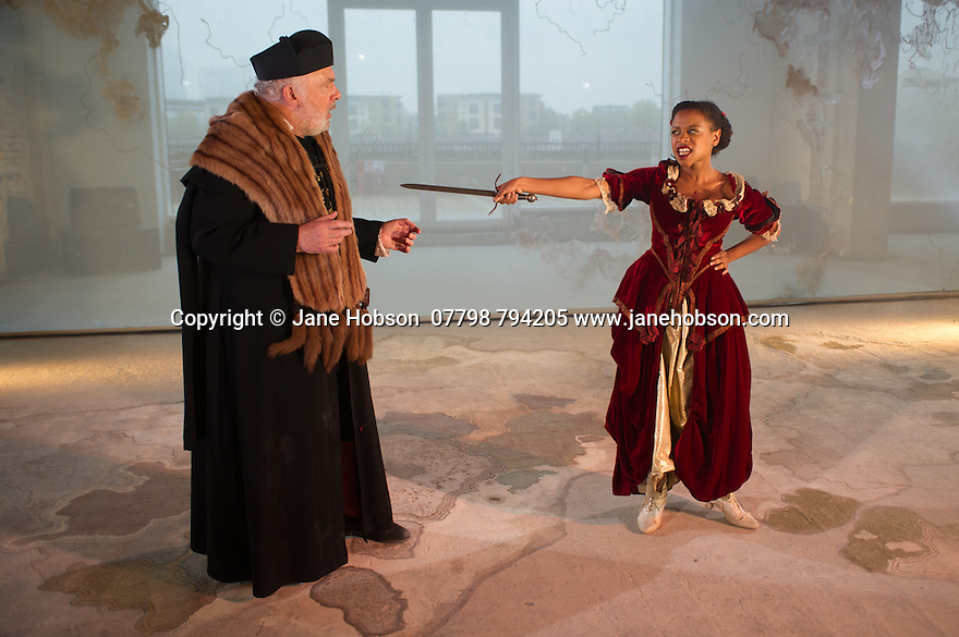 London, UK. 25.04.2014. VENICE PRESERV'D, a site responsive production, by the Spectators' Guild, opens at Payne & Borthwick Wharf. Picture shows: Pip Donaghy (Antonio) and Ayesha Antoine (Aquilina). Photograph © Jane Hobson.